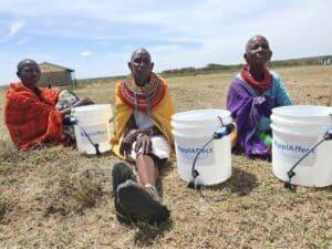 RipplAffect Samburu - 3 women sitting with buckets