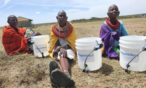 RipplAffect Samburu - 3 women sitting with buckets