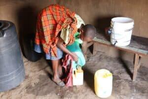 RipplAffect Samburu Kenya - woman with water bucket